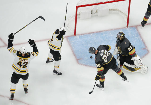 Boston Bruins' David Backes (42) and Chris Wagner celebrate after Torey Krug scored against the Vegas Golden Knights during the second period of an NHL hockey game Tuesday, Oct. 8, 2019, in Las Vegas. (AP Photo/John Locher)