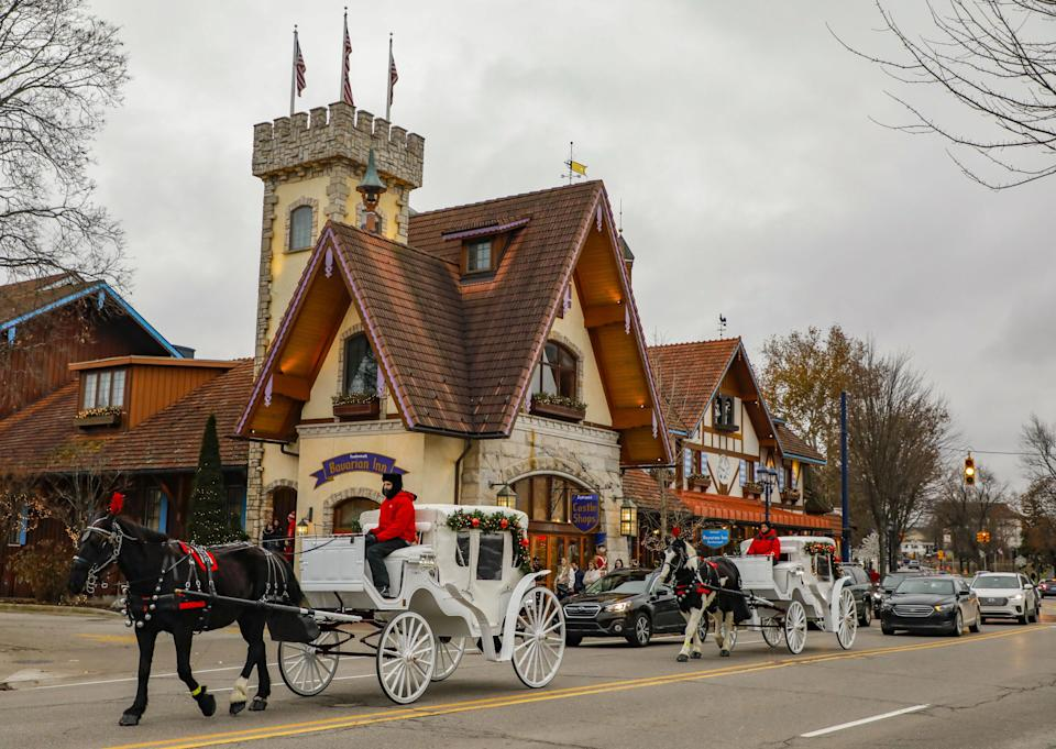 Two horse-drawn carriages are seen in the Bavarian-themed town of Frankenmuth in Michigan