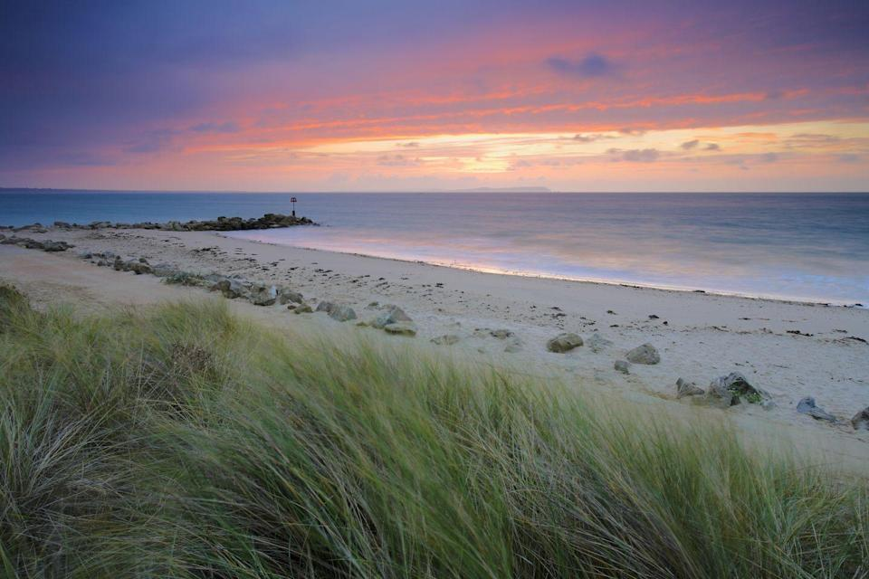 "<p>Hengistbury Head is a headland (hence the name!) protruding into the English Channel between Bournemouth and Mudeford in the English countryside of Dorset. Look at that sunset!<br></p><p><a class=""link rapid-noclick-resp"" href=""https://go.redirectingat.com?id=127X1599956&url=https%3A%2F%2Fwww.booking.com%2Findex.en-gb.html%3Flabel%3Dgen173nr-1BCAEoggI46AdIM1gEaFCIAQGYAQm4AQfIAQzYAQHoAQGIAgGoAgO4AoaD8PkFwAIB0gIkMjllNzUwZjMtNzJjNi00ZmQxLTlmZTYtNjljZDNkZGUzNGZm2AIF4AIB%26sid%3Dd557a040829a867b722f4b6cf8934591%26keep_landing%3D1%26sb_price_type%3Dtotal&sref=https%3A%2F%2Fwww.cosmopolitan.com%2Fuk%2Fentertainment%2Ftravel%2Fg4958%2Fbest-beaches-in-uk%2F"" rel=""nofollow noopener"" target=""_blank"" data-ylk=""slk:FIND ACCOMMODATION"">FIND ACCOMMODATION </a></p>"