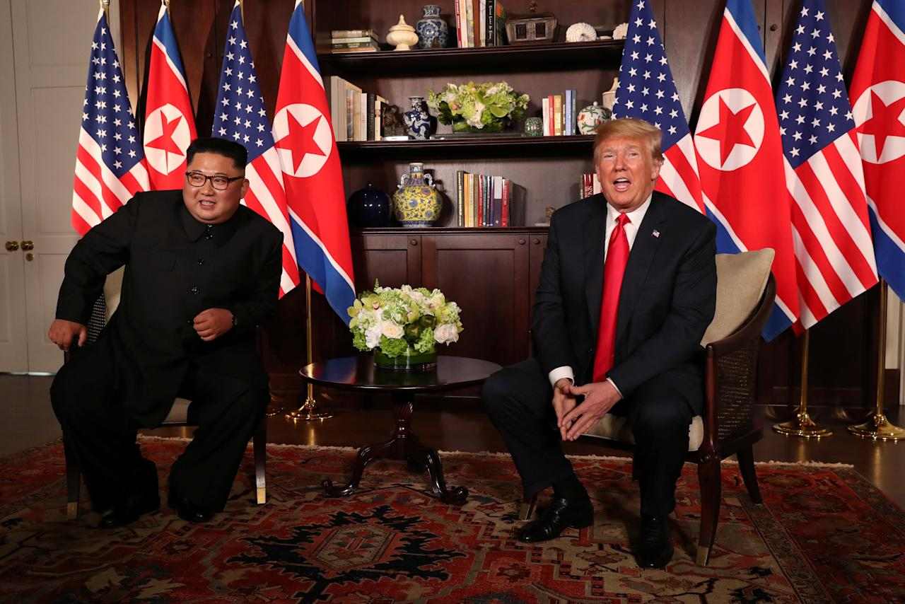 <p>US President Donald Trump sits with North Korean leader at the Capella Hotel on Sentosa island on 12 June 2018. (PHOTO: Reuters) </p>