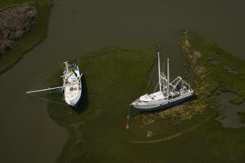 In this aerial photo, damaged ships are seen in the aftermath of Hurricane Ida, Monday, Sept. 6, 2021, in Golden Meadow, La. (AP Photo/Matt Slocum)
