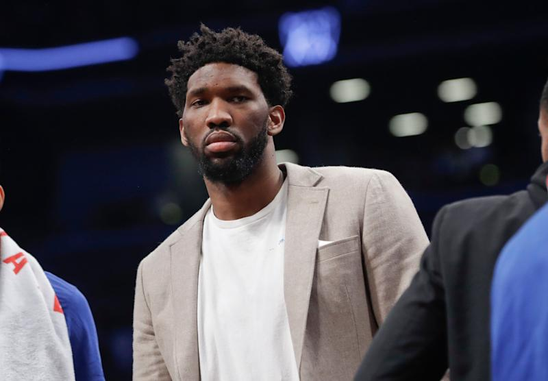 Philadelphia 76ers' Joel Embiid watches during the first half in Game 3 of the team's first-round NBA basketball playoff series against the Brooklyn Nets on Thursday, April 18, 2019, in New York. (AP Photo/Frank Franklin II)
