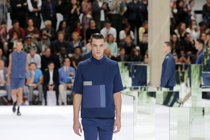 A model presents a creation as part of Dior men's fashion Spring-Summer 2014 collection, presented Saturday, June 29, 2013 in Paris. (AP Photo/Jacques Brinon)
