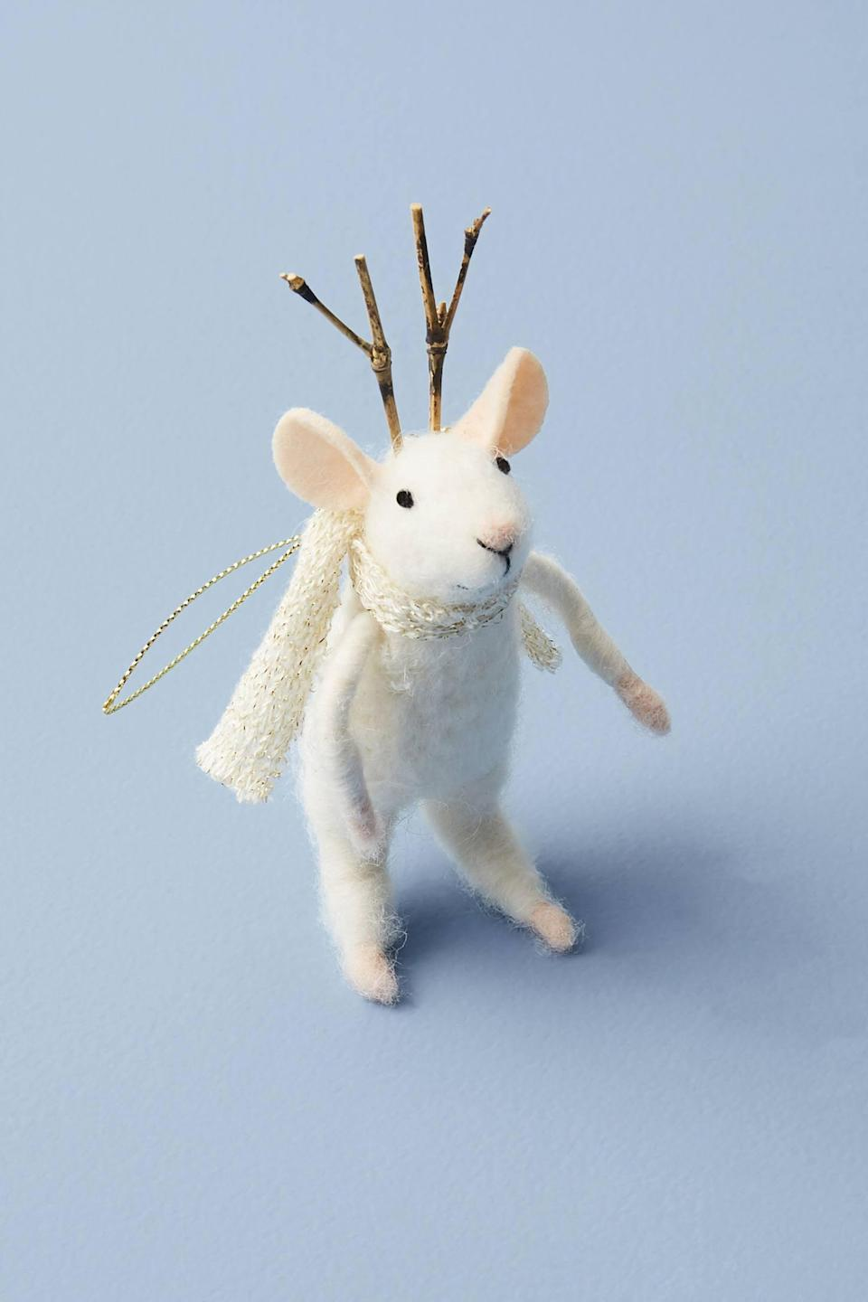 """<p>Dressed in a shimmery scarf and antlers, you can't say no to this cute <a href=""""https://www.popsugar.com/buy/Cozy-Mouse-Ornament-490448?p_name=Cozy%20Mouse%20Ornament&retailer=anthropologie.com&pid=490448&price=16&evar1=casa%3Aus&evar9=46615300&evar98=https%3A%2F%2Fwww.popsugar.com%2Fhome%2Fphoto-gallery%2F46615300%2Fimage%2F46615318%2FCozy-Mouse-Ornament&list1=shopping%2Canthropologie%2Choliday%2Cchristmas%2Cchristmas%20decorations%2Choliday%20decor%2Chome%20shopping&prop13=mobile&pdata=1"""" rel=""""nofollow noopener"""" class=""""link rapid-noclick-resp"""" target=""""_blank"""" data-ylk=""""slk:Cozy Mouse Ornament"""">Cozy Mouse Ornament</a> ($16).</p>"""