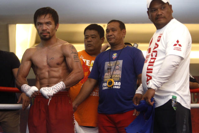 Philippine senator and boxing champion Manny Pacquiao trains at a press preview in Kuala Lumpur, Malaysia, Wednesday, July 11, 2018. Pacquiao is scheduled to fight Lucas Matthysse on July 15, 2018, for the World Boxing Association welterweight title in Malaysia. (AP Photo/Yam G-Jun)
