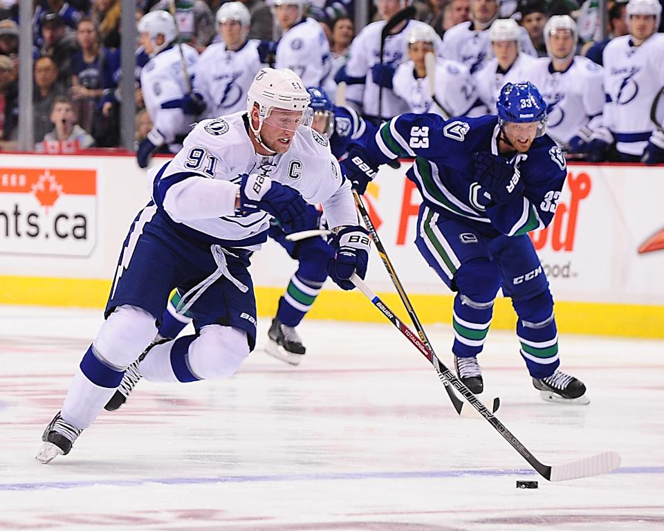 Oct 18, 2014; Vancouver, British Columbia, CAN; Tampa Bay Lightning forward Steven Stamkos (91) on a break away before scoring against Vancouver Canucks goaltender Eddie Lack (not pictured) during the first period at Rogers Arena. (Anne-Marie Sorvin-USA TODAY Sports)
