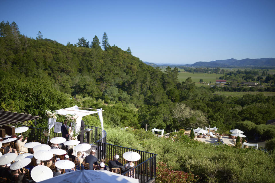 "In this spring 2017 photo, provided by Bob McClenahan, a wedding taking place at a remote location in California's Napa Valley. ""If the fires make major news every year, it's going to keep people from wanting to make long-term plans to vacation here,"" said McClenahan, a photographer who lost all his wedding gigs this year. ""I worry that eventually people don't want to come to California in October because you just don't know what may happen."" (Bob McClenahan via AP)"