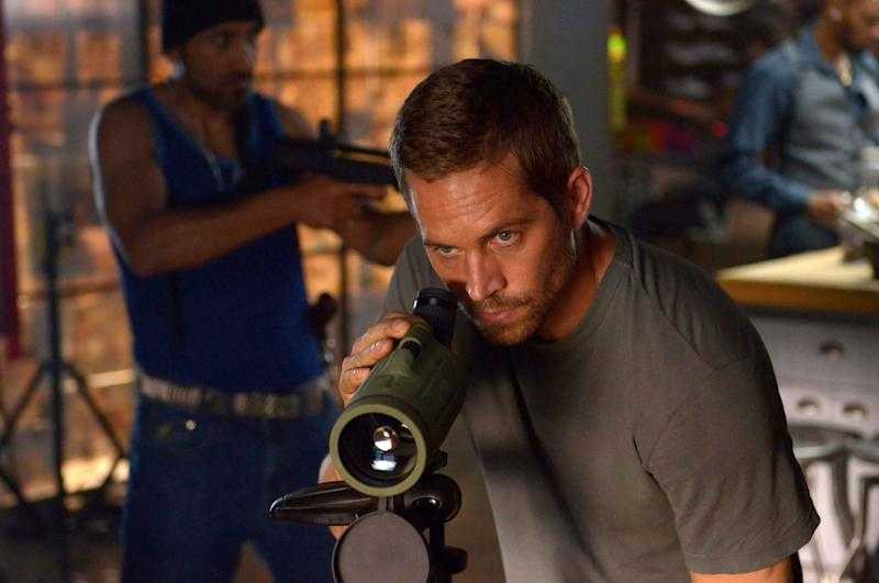 """This image released by Relativity Media shows Paul Walker in a scene from """"Brick Mansions."""" (AP Photo/Relativity Media, Philippe Bosse)"""