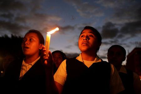 A vigil for victims after a fire broke out at the Virgen de Asuncion home in San Jose Pinula, on the outskirts of Guatemala City, March 9, 2017. REUTERS/Saul Martinez