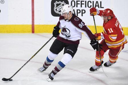 Apr 11, 2019; Calgary, Alberta, CAN; Calgary Flames center Mikael Backlund (11) chases after Colorado Avalanche right wing Mikko Rantanen (96) during the third period in game one of the first round of the 2019 Stanley Cup Playoffs at Scotiabank Saddledome. Flames won 4-0. Mandatory Credit: Candice Ward-USA TODAY Sports