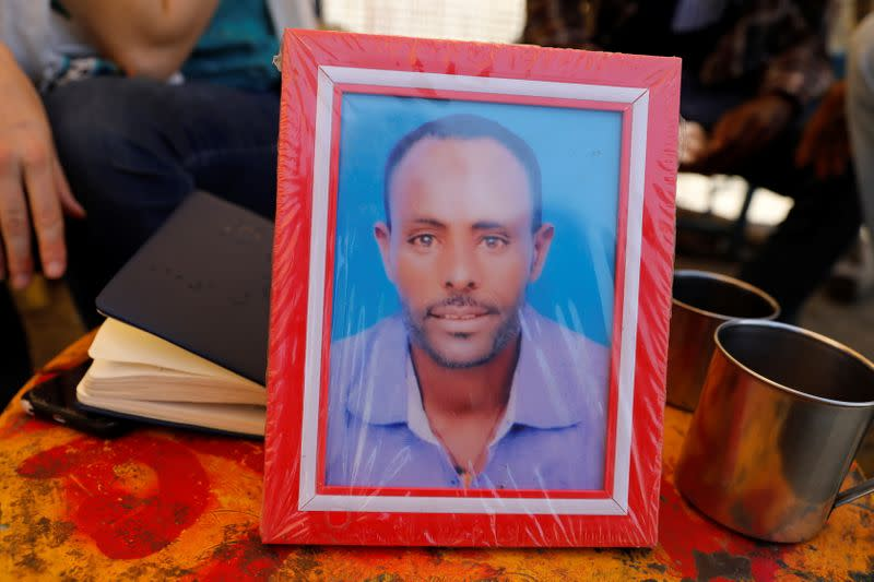 Photo of Dejen Wase, who was killed in ethnic violence, is seen during a memorial service in the town of Mai Kadra