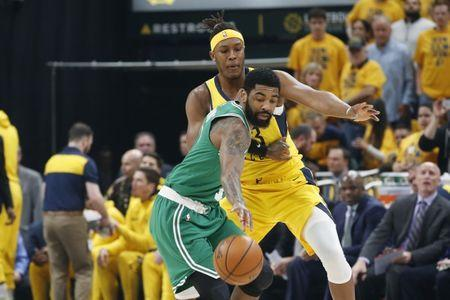 Apr 19, 2019; Indianapolis, IN, USA; Boston Celtics guard Kyrie Irving (11) dribbles the ball againts Indiana Pacers center Myles Turner (33) during the first quarter in game three of the first round of the 2019 NBA Playoffs at Bankers Life Fieldhouse. Mandatory Credit: Brian Spurlock-USA TODAY Sports