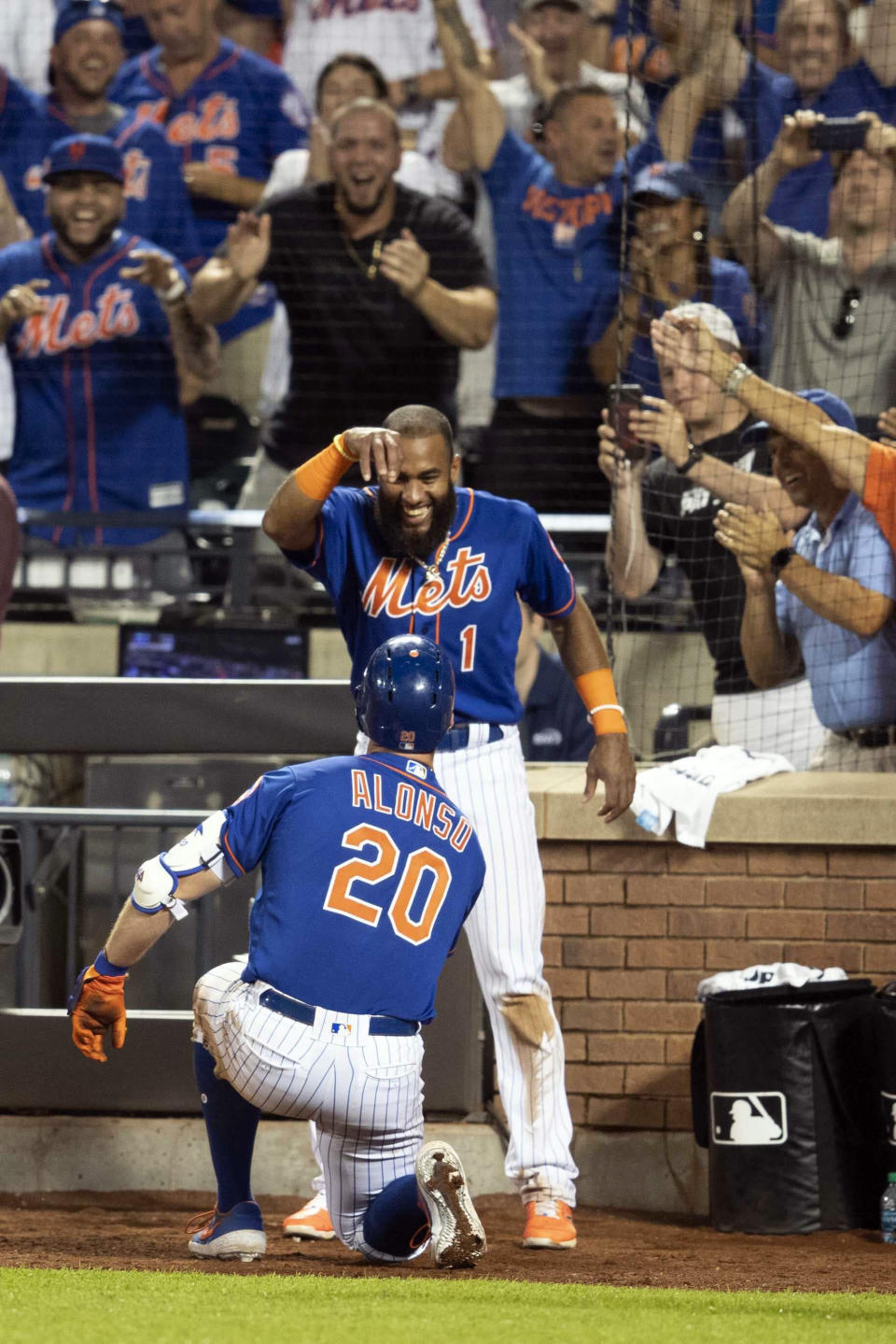 New York Mets' Pete Alonso (20) celebrates his home run with Amed Rosario (1) during the seventh inning in the second game of a baseball doubleheader against the Miami Marlins, Monday, Aug. 5, 2019, in New York. (AP Photo/Mary Altaffer)