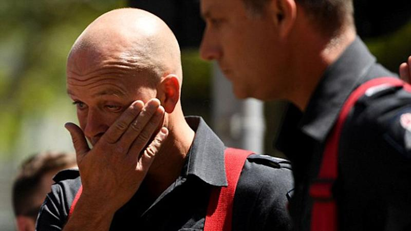 Devastated firefighters were among those in attendance at a memorial for those killed in the Bourke Street massacre. Source: AAP