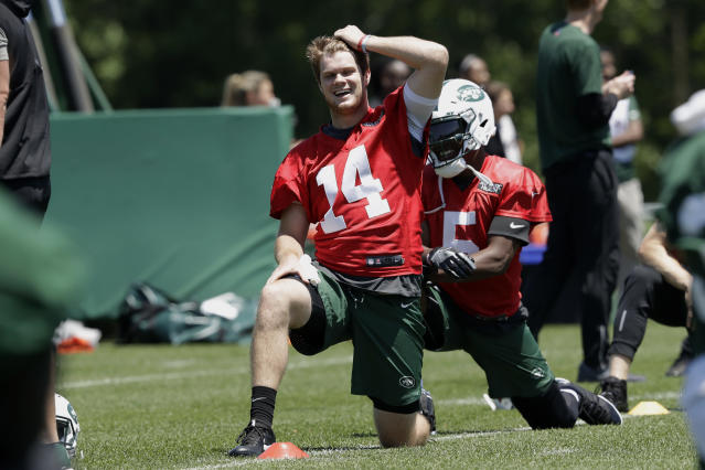 New York Jets quarterback Sam Darnold stretches during practice at the NFL football team's training camp, Tuesday, June 12, 2018, in Florham Park, N.J. (AP Photo/Mark Lennihan)