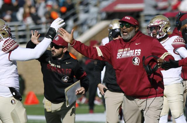 Florida State interim head coach Odell Haggins cheers his team after a defensive stop in the first half of an NCAA college football game against Boston College, Saturday, Nov. 9, 2019, in Boston. (AP Photo/Bill Sikes)
