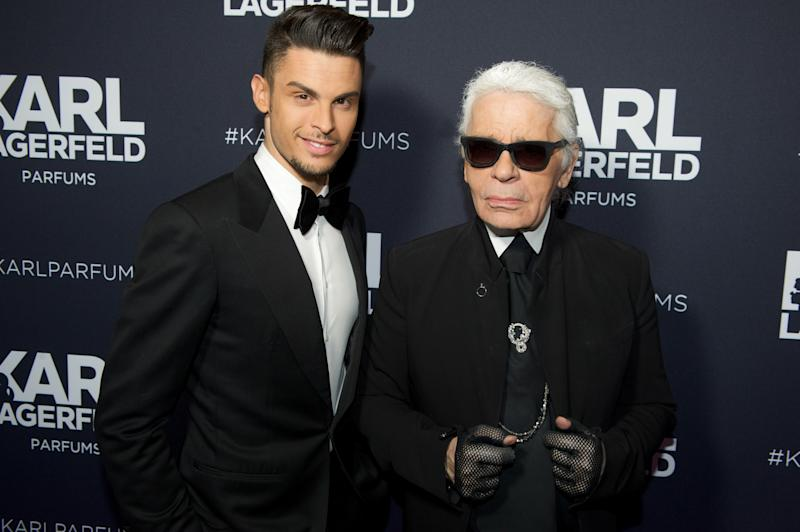 Karl Lagerfeld and Baptiste Giabiconi attend the Karl Lagerfeld New Perfume launch party at Palais Brongniart, in Paris. (Photo by Stephane Cardinale/Corbis via Getty Images)
