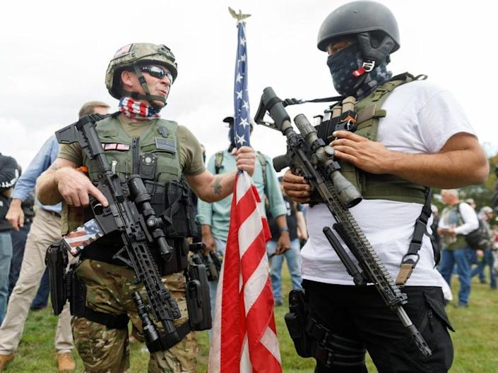 """The Proud Boys, a right-wing pro-Trump group, are heavily armed with military weapons gather with their allies in a rally called 'End Domestic Terrorism' against Antifa in Portland, Oregon on September 26, 2020. <p class=""""copyright"""">John Rudoff/Anadolu Agency via Getty Images</p>"""