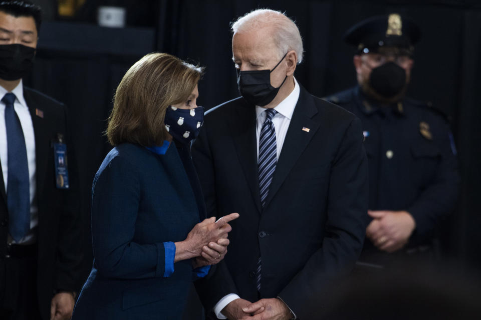 """House Speaker Nancy Pelosi, D-Calif., speaks with President Joe Biden as they attend the service for U.S. Capitol Officer William """"Billy"""" Evans, as his remains lie in honor in the Capitol Rotunda, Tuesday, April 13, 2021 in Washington. (Tom Williams/Pool via AP)"""
