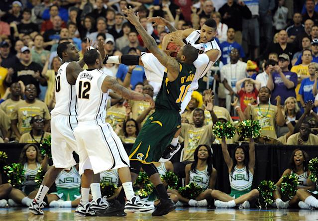 OMAHA, NE - MARCH 16: Phil Pressey #1 of the Missouri Tigers attempts to take the ball from Kyle O'Quinn #10 of the Norfolk State Spartans in the final minutes of the game during the second round of the 2012 NCAA Men's Basketball Tournament at CenturyLink Center on March 16, 2012 in Omaha, Nebraska. (Photo by Eric Francis/Getty Images)