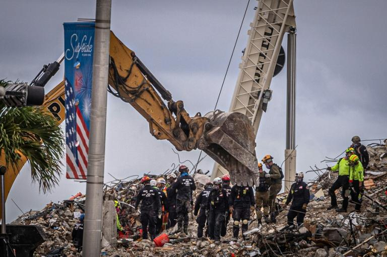 Search and rescue teams look for possible survivors in the rubble of the partially collapsed 12-story Champlain Towers South on June 28, 2021 in Surfside, Florida