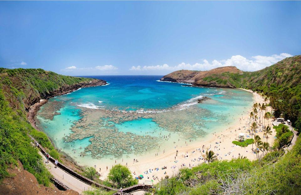 """<p><strong>Hanauma Bay</strong></p><p>We couldn't leave Hawaii out because you could be taking a road trip <em>in</em> Hawaii! Hanauma Bay is a marine embayment formed within a tuff ring along the southeast coast of <a href=""""https://www.gohawaii.com/islands/oahu"""" rel=""""nofollow noopener"""" target=""""_blank"""" data-ylk=""""slk:O'ahu"""" class=""""link rapid-noclick-resp"""">O'ahu</a>. Explore the reefs, swim in the crystal blue waters and take in the greenery.</p>"""