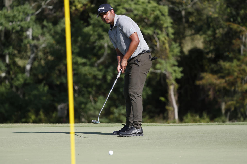 Sebastian Munoz, of Colombia, watches his putt on the 16th green during the third round of the Sanderson Farms Championship golf tournament in Jackson, Miss., Saturday, Sept. 21, 2019. (AP Photo/Rogelio V. Solis)