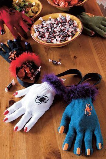 """<p>Fill gloves with your favorite little candies to hand out to all your guests.</p><p><strong><em><a href=""""https://www.womansday.com/home/crafts-projects/a28915338/hag-bags/"""" rel=""""nofollow noopener"""" target=""""_blank"""" data-ylk=""""slk:Get the Hag Bags tutorial"""" class=""""link rapid-noclick-resp"""">Get the Hag Bags tutorial</a>.</em></strong></p><p><a class=""""link rapid-noclick-resp"""" href=""""https://www.amazon.com/VATIN-Grosgrain-50-Yard-Wrapping-Projects/dp/B08BLDYV5D?tag=syn-yahoo-20&ascsubtag=%5Bartid%7C10070.g.1908%5Bsrc%7Cyahoo-us"""" rel=""""nofollow noopener"""" target=""""_blank"""" data-ylk=""""slk:SHOP BLACK RIBBON"""">SHOP BLACK RIBBON</a></p>"""