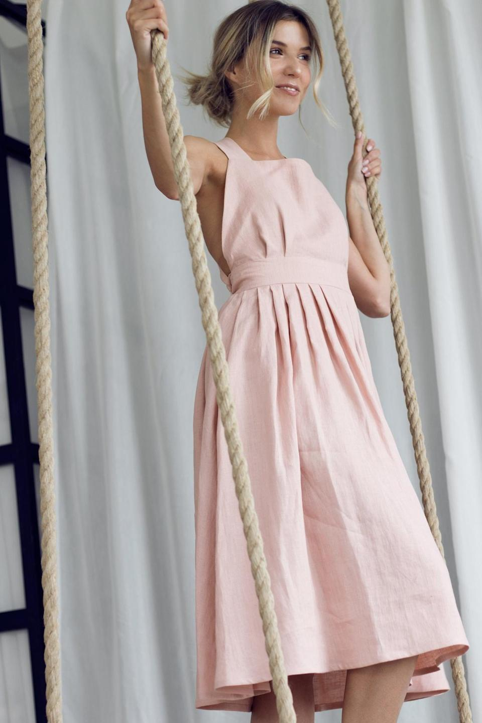 "<p>This <a href=""https://www.popsugar.com/buy/Etsy-Crossback-Linen-Dress-576338?p_name=Etsy%20Crossback%20Linen%20Dress&retailer=etsy.com&pid=576338&price=102&evar1=fab%3Aus&evar9=47495570&evar98=https%3A%2F%2Fwww.popsugar.com%2Fphoto-gallery%2F47495570%2Fimage%2F47496470%2FEtsy-Crossback-Linen-Dress&list1=shopping%2Cdresses%2Csummer%20fashion%2Cfashion%20shopping&prop13=api&pdata=1"" class=""link rapid-noclick-resp"" rel=""nofollow noopener"" target=""_blank"" data-ylk=""slk:Etsy Crossback Linen Dress"">Etsy Crossback Linen Dress</a> ($102) is available in many shades.</p>"