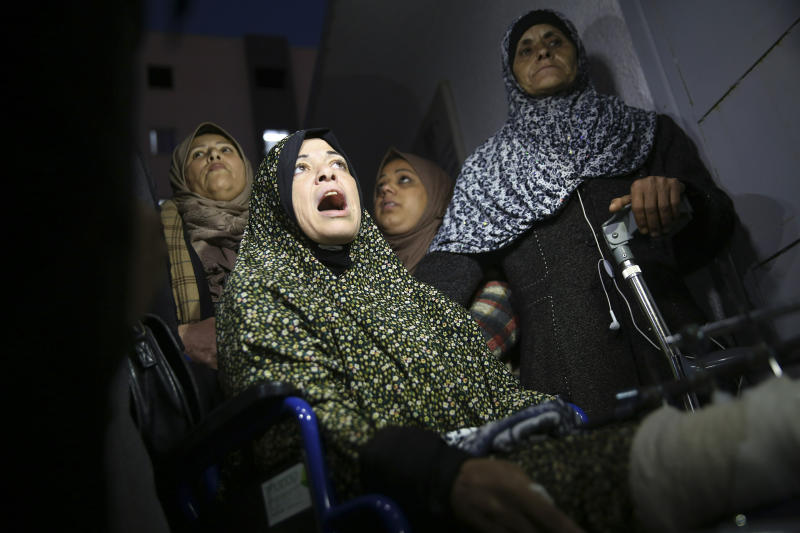 Relatives react in front of the morgue of Shifa hospital while wait to see the body of a woman who was shot and killed by Israeli troops during a protest at the Gaza Strip's border with Israel, in Gaza City, Friday, Jan. 11, 2019. Spokesman Ashraf al-Kidra says the woman was shot in the head Friday at a protest site east of Gaza City. (AP Photo/Adel Hana)