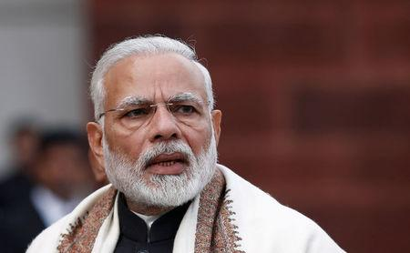 FILE PHOTO: India's Prime Minister Narendra Modi speaks with the media inside the parliament premises on the first day of the budget session, in New Delhi
