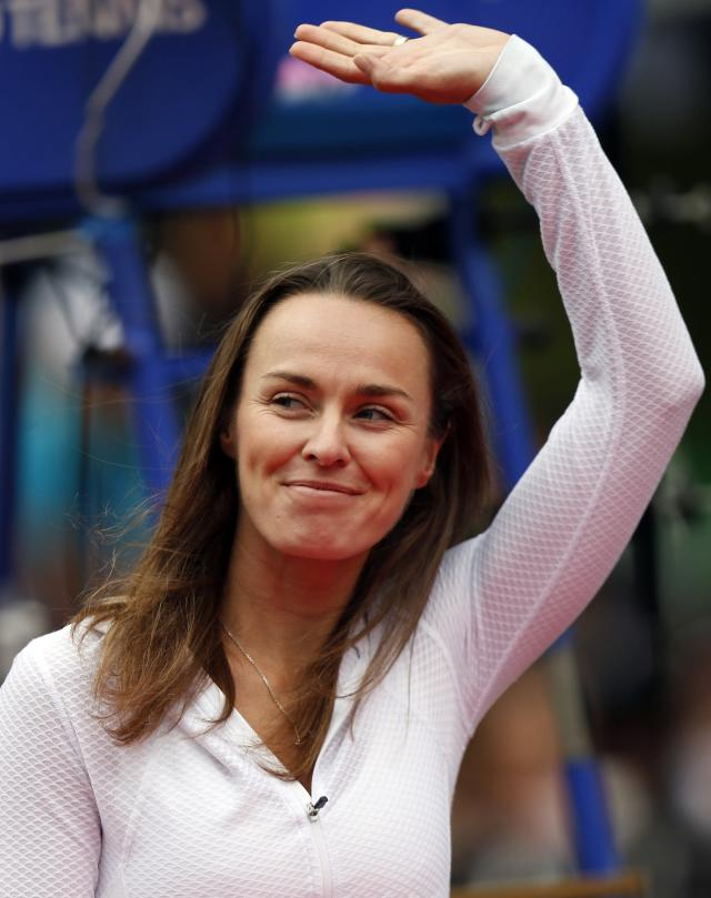 Martina Hingis of Switzerland waves at a ceremony to celebrate the 30th anniversary of the Pan Pacific Open tennis tournament after the women's final match between Petra Kvitova of the Czech Republic and Angelique Kerber of Germany in Tokyo September 28, 2013. REUTERS/Toru Hanai (JAPAN - Tags: SPORT TENNIS HEADSHOT)