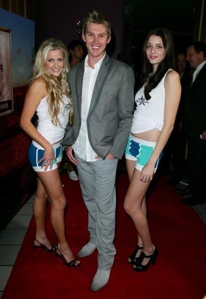 SYDNEY, AUSTRALIA - AUGUST 19:  Australian cricketer Brett Lee poses alongside models during the official launch of the AceStar underwear range at Pink Salt on August 19, 2008 in Sydney, Australia.  (Photo by Don Arnold/WireImage)