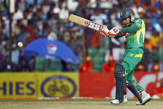 Bangladesh's Mushfiqur Rahim plays a shot during the Asia Cup one-day international cricket tournament against India in Fatullah, near Dhaka, Bangladesh, Wednesday, Feb. 26, 2014. (AP Photo/A.M. Ahad)