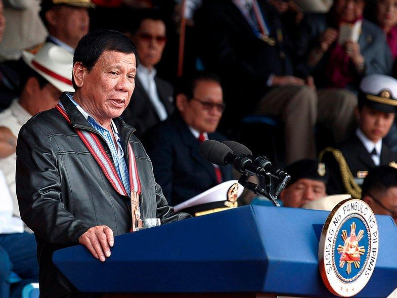 Philippine President Rodrigo Duterte delivers a speech during the Philippine Military Academy (PMA) alumni homecoming in Fort Del Pilar, Baguio city, north of Manila, Philippines February 18, 2017. REUTERS/Harley Palangchao