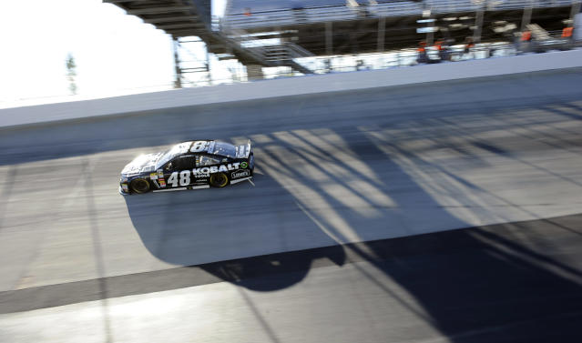 Jimmie Johnson competes during a NASCAR Sprint Cup Series auto race on Sunday, Sept. 29, 2013, at Dover International Speedway in Dover, Del. Johnson won the race. (AP Photo/Nick Wass)