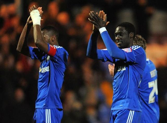 "Macclesfield Town's Guinean midfielder Arnaud Mendy (R) celebrates at the final whistle after his side drew 2-2 during the FA Cup football match between Macclesfield Town and Bolton Wanderers at Moss Rose, in Macclesfield, north-west England, on January 7 2012. (Photo by Andrew Yates. Restricted To Editorial Use. No Use With Unauthorized Audio, Video, Data, Fixture Lists, Club/league Logos Or ""live"" Services. Online In-match Use Limited To 45 Images, No Video Emulation. No Use In Betting, Games Or Single Club/league/player Publications. /AFP/Getty Images)"
