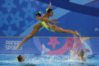 Members of Colombia's artistic swimming team compete in the free routine event at the Pan American Games in Lima, Peru, Wednesday, July 31, 2019. (AP Photo/Moises Castillo)