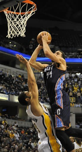 Charlotte Bobcats guard Jeffery Taylor (44) shoots over Indiana Pacers power forward Jeff Pendergraph (29) in the first half of an NBA basketball game in Indianapolis Wednesday, Feb. 13, 2013. (AP Photo/ Alan Petersime)