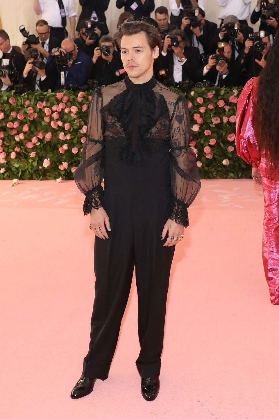 <p>Alright, so technically this is not a <em>full blown</em> suit, but we're not just gonna ignore this Met Gala ensemble by Gucci that makes Harry's legs look miles long, okay? </p>