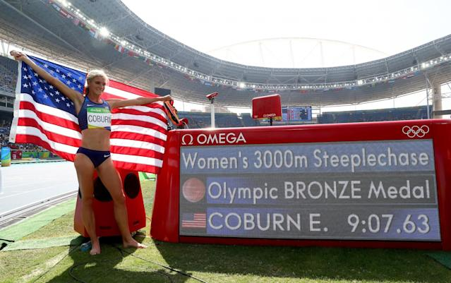 <p>Emma Coburn of the United States celebrates placing third in the Women's 3000m Steeplechase final on Day 10 of the Rio 2016 Olympic Games at the Olympic Stadium on August 15, 2016 in Rio de Janeiro, Brazil. (Photo by Alexander Hassenstein/Getty Images) </p>