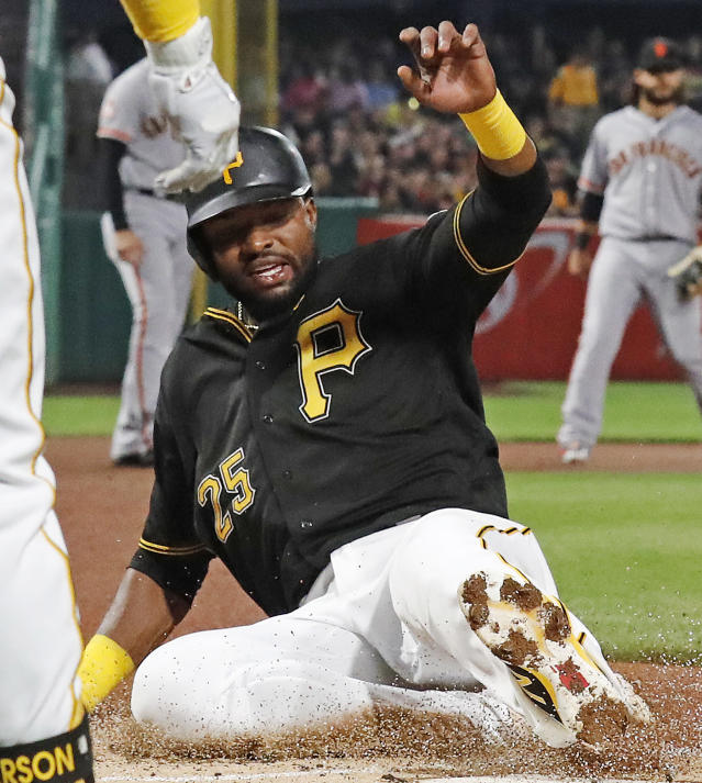 Pittsburgh Pirates' Gregory Polanco scores on a sacrifice fly by Josh Bell off San Francisco Giants starting pitcher Jeff Samardzija during the first inning of a baseball game in Pittsburgh, Saturday, May 12, 2018. (AP Photo/Gene J. Puskar)