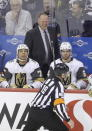 Referee Gord Dwyer (19) talks to a laughing Vegas Golden Knights coach Gerard Gallant after Dwyer and a linesman cleared a buildup of snow from the crease when the Knights pulled goaltender Marc-Andre Fleury (29) during the third period of an NHL hockey game against the Winnipeg Jets on Tuesday, Jan. 15, 2019, in Winnipeg, Manitoba. (Trevor Hagan/The Canadian Press via AP)