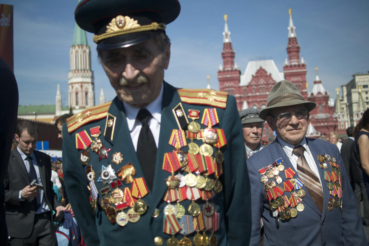 Russian WWII veterans walk after the Victory Day parade at Red Square on Thursday, May 9, 2013. Russian President Vladimir Putin said at the annual military parade hat Russia will be a guarantor of world security. Putin's short speech came at the culmination of Victory Day, marking the defeat of Nazi Germany 68 years ago. It is Russia's most important secular holiday, honoring the huge military and civilian losses of World War II and showing off the country's modern arsenal. (AP Photo/Ivan Sekretarev)