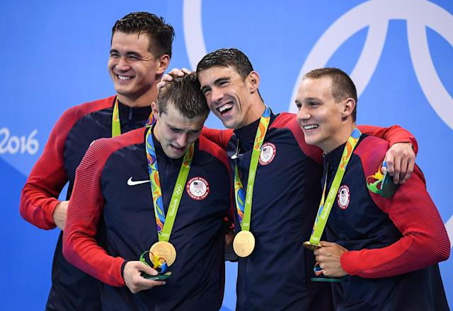 <p>From left, Nathan Adrian, Ryan Held, Michael Phelps and Caeleb Dressel with their gold medals after they won the Men's 4 x 100m Freestyle Relay at the Olympic Aquatic Stadium on August 7, 2016. via Getty Images) </p>