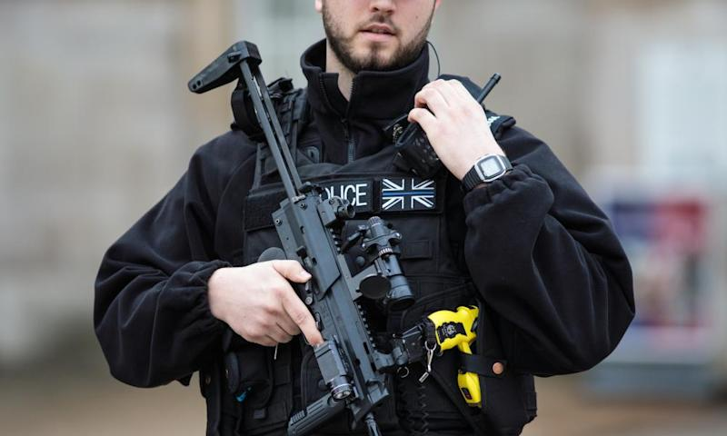An armed police officer stands guard in London
