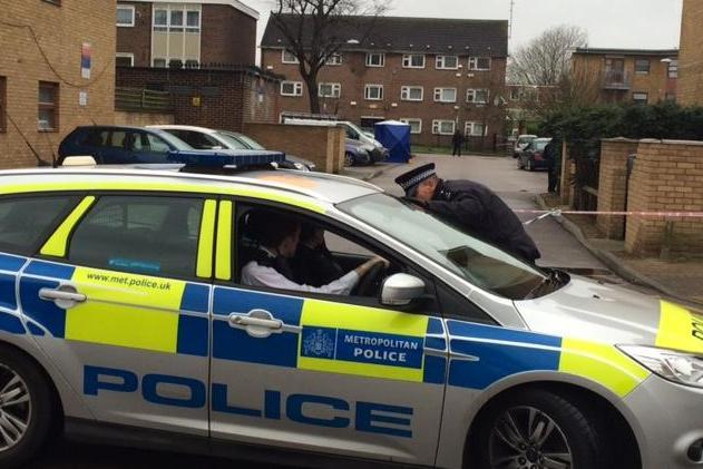 Police presence: Officers at the scene of the shooting in Barking: John Dunne