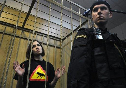 Nadezhda Tolokonnikova, a member of female Russian punk band Pussy Riot, stands inside the defendant's cage of a Moscow court on Thursday. A Moscow court Thursday extended until late June the pretrial detention of two young members of the band whose stunt performance in Russia's main cathedral has drawn fury from the Church