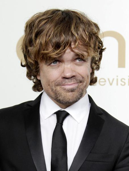 "FILE - In this Sept. 18, 2011 file photo, Peter Dinklage from the HBO series ""Game of Thrones"" poses backstage at the 63rd Primetime Emmy Awards in Los Angeles. Dinklage won the Emmy for best supporting actor in a drama series for his role as Tyrion Lannister. Dinklage, 43, who has been a vegetarian since he was 16, is the national spokesman for Farm Sanctuary's annual Walk for Farm Animals. He has filmed a YouTube video and will spend his off season promoting the group's campaign to change the way society views and treats farm animals. (AP Photo/Jae Hong, file)"