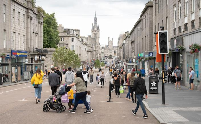 Residents walk in central in Aberdeen, eastern Scotland on August 5, 2020 following the announcement that a local lockdown has been imposed on the city after a spike in the number of cases of novel coronavirus COVID-19. - Scotland will reimpose lockdown restrictions in and around the city of Aberdeen after recording dozens of new coronavirus cases there this week, First Minister Nicola Sturgeon said today. (Photo by Michal Wachucik / AFP) (Photo by MICHAL WACHUCIK/AFP via Getty Images)
